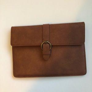 Large brown envelope clutch.